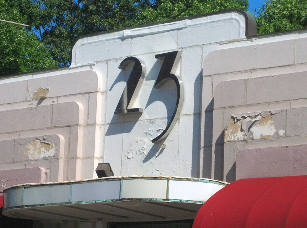 Dimensional letters '23' on a building
