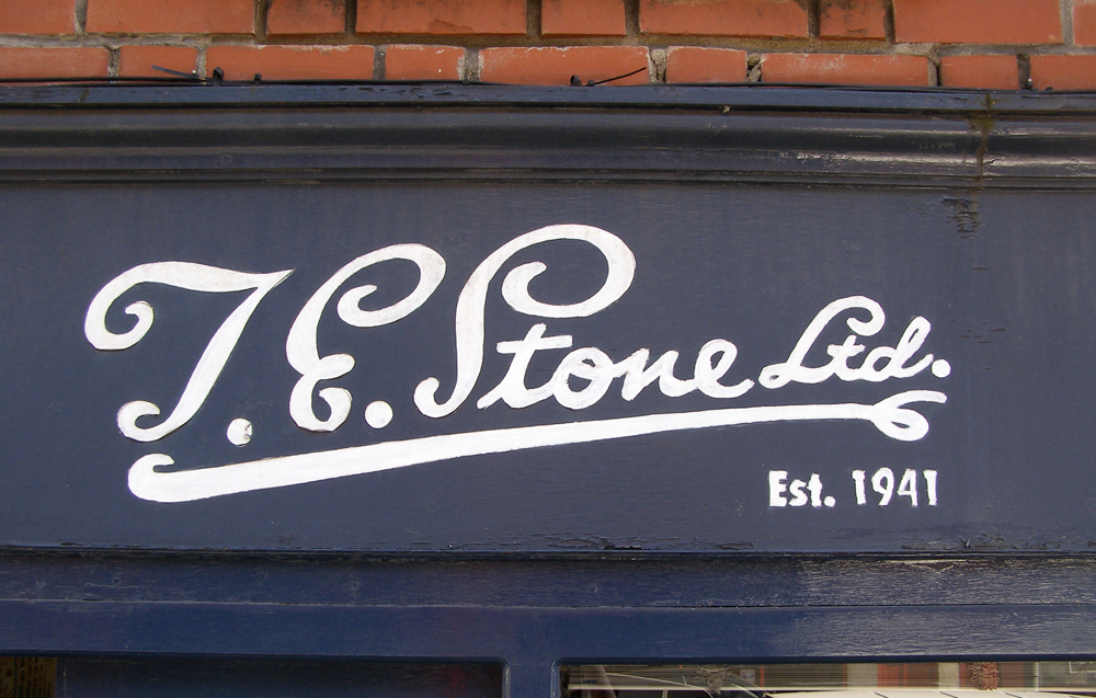 T.E. Stone Ltd. hand-painted sign.
