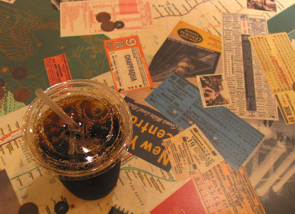 A cup of iced coffee on a table in Grand Central Station.