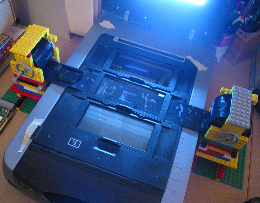 Scanner set up to scan a film font using a feed system constructed of Legos