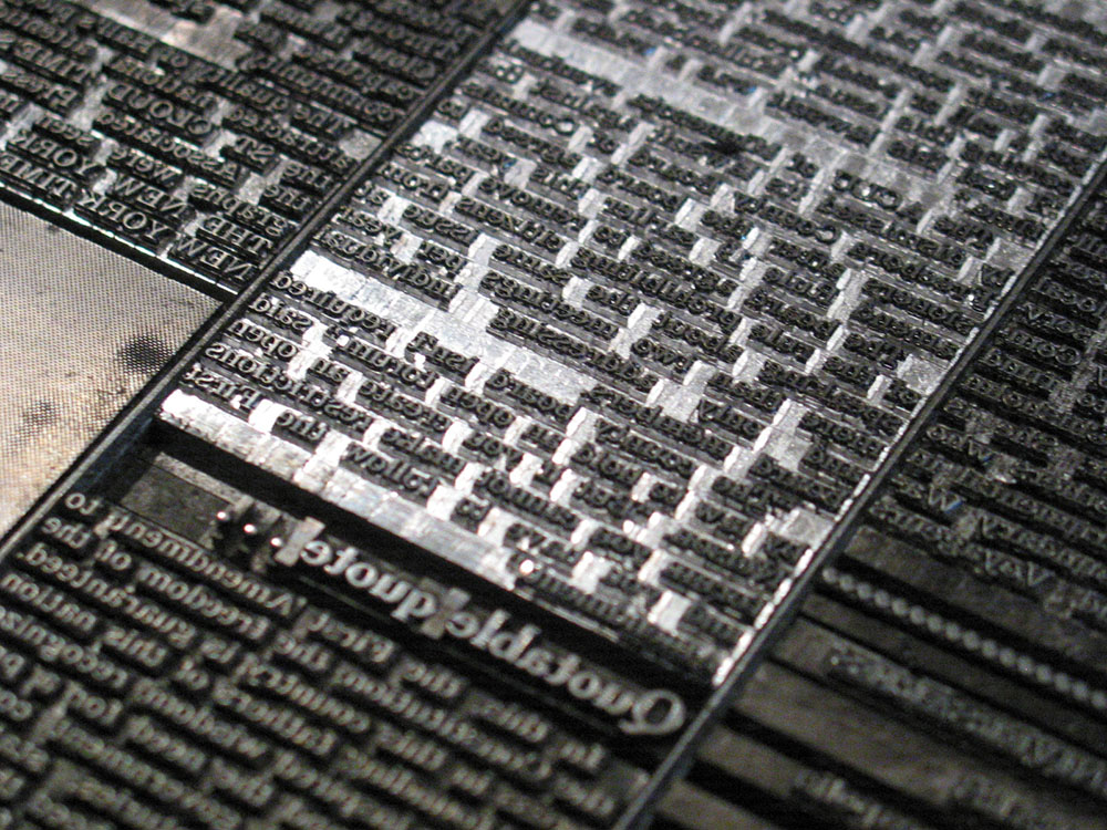 Metal type for a newspaper page.