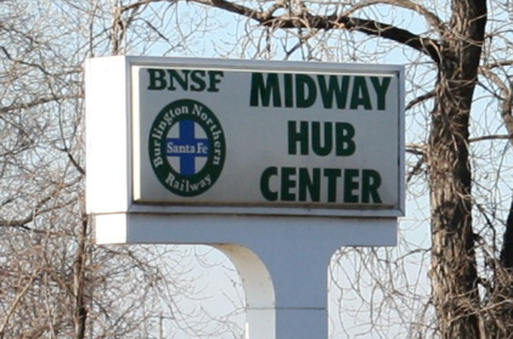 Sign reads: Midway Hub Center