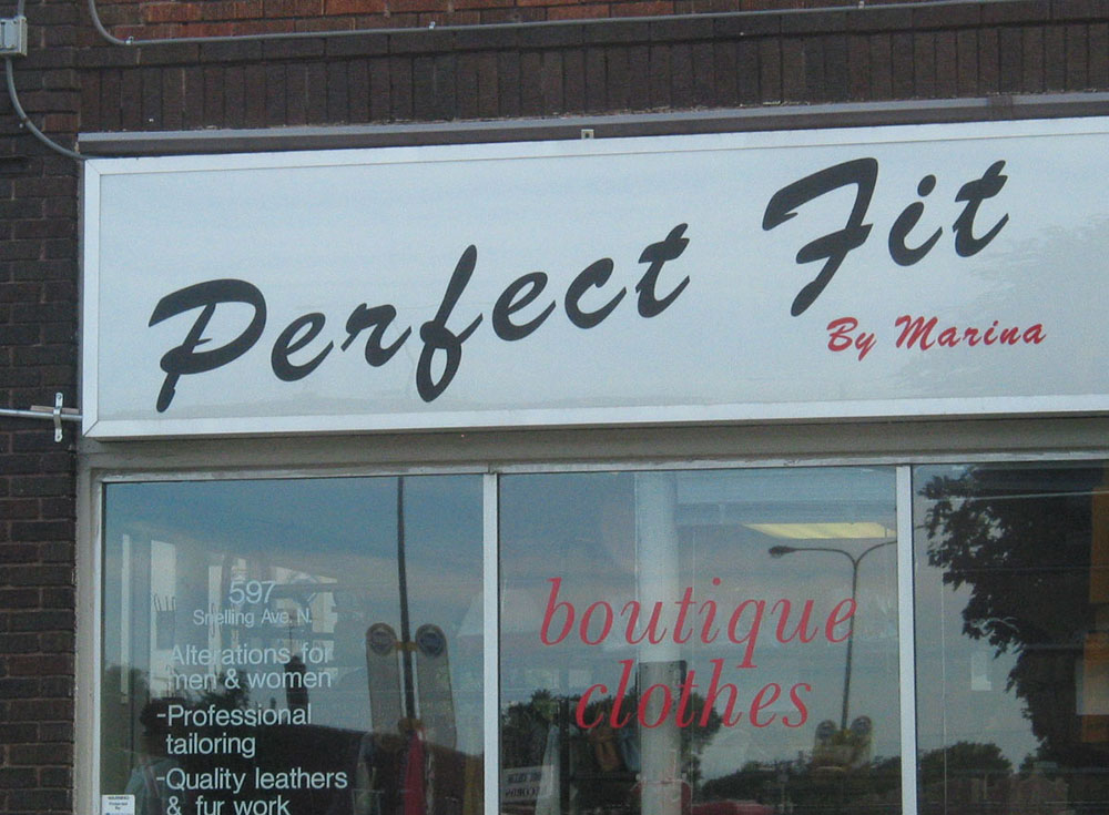 Photo of badly spaced vinyl sign reading 'Perfect Fit'