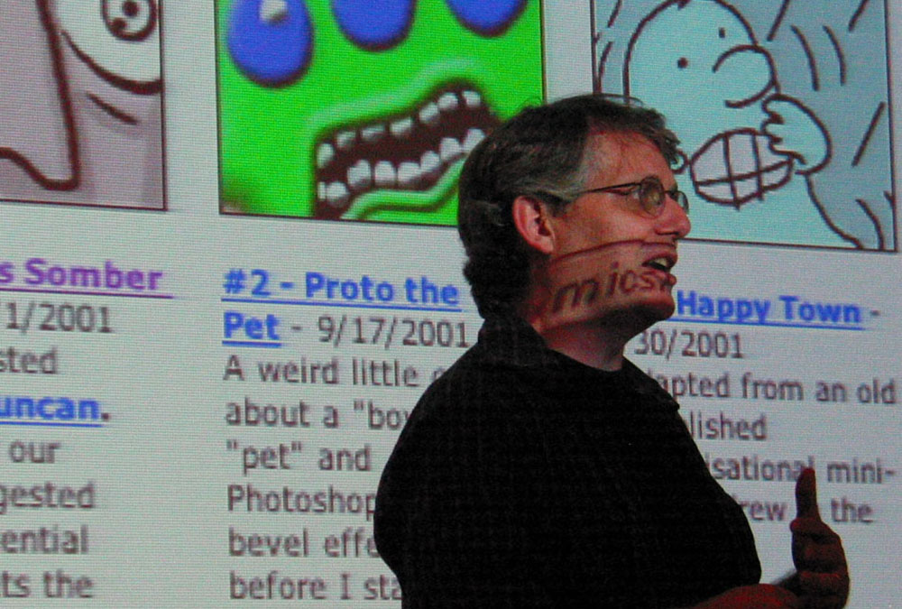Photo of Scott McCloud in front of a projected computer image